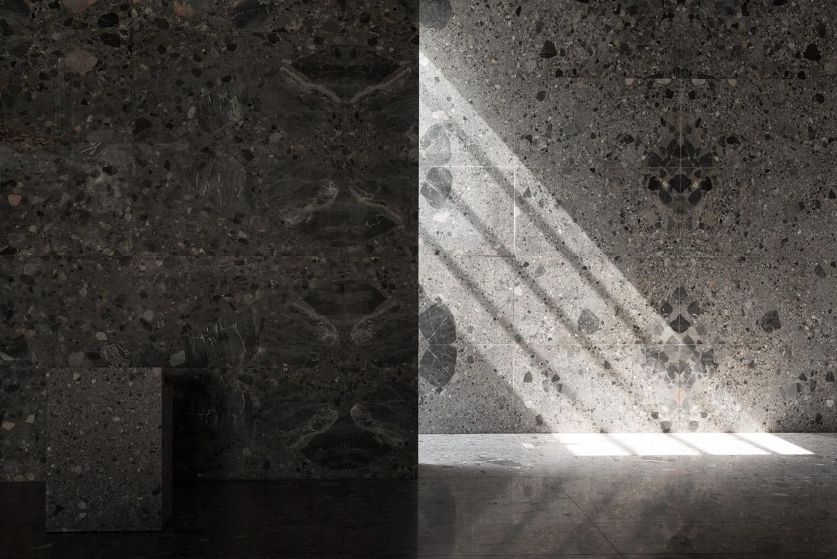 <p>De bijzondere lichtinval op de marmeren muur draagt bij aan een sereen gevoel in de ceremoniezaal. Beeld Simone Bossi</p>