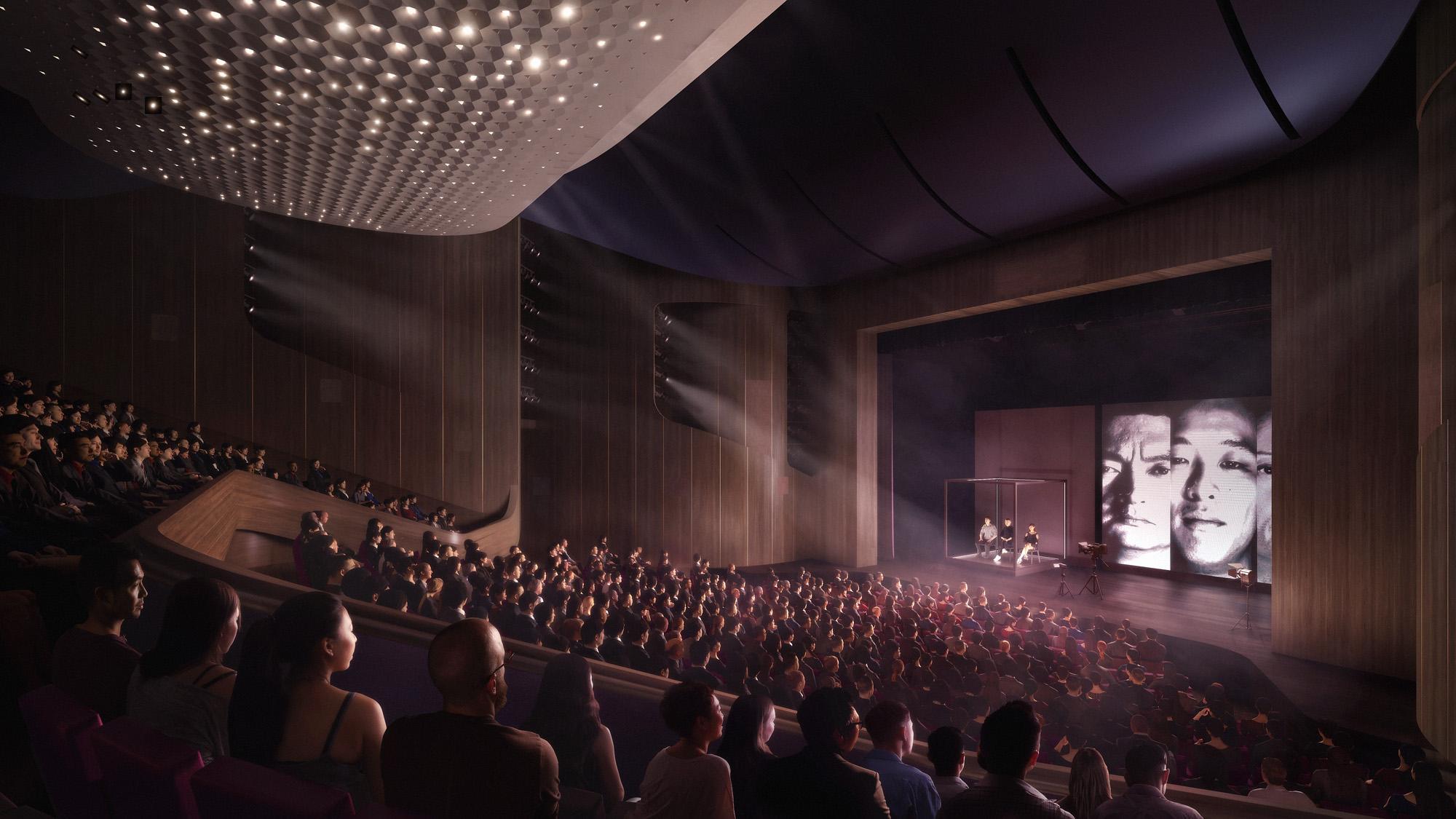 <p>De intiemere zaal van het Medium Theater biedt plaats aan 600 toeschouwers en is bedoeld voor toneel- en dansvoorstellingen. De zaal is uitgevoerd in diep donkerpaars, en een contrasterend notenhouten interieur met metalen details.  Beeld: Hong Kong Repertory Theatre</p>
