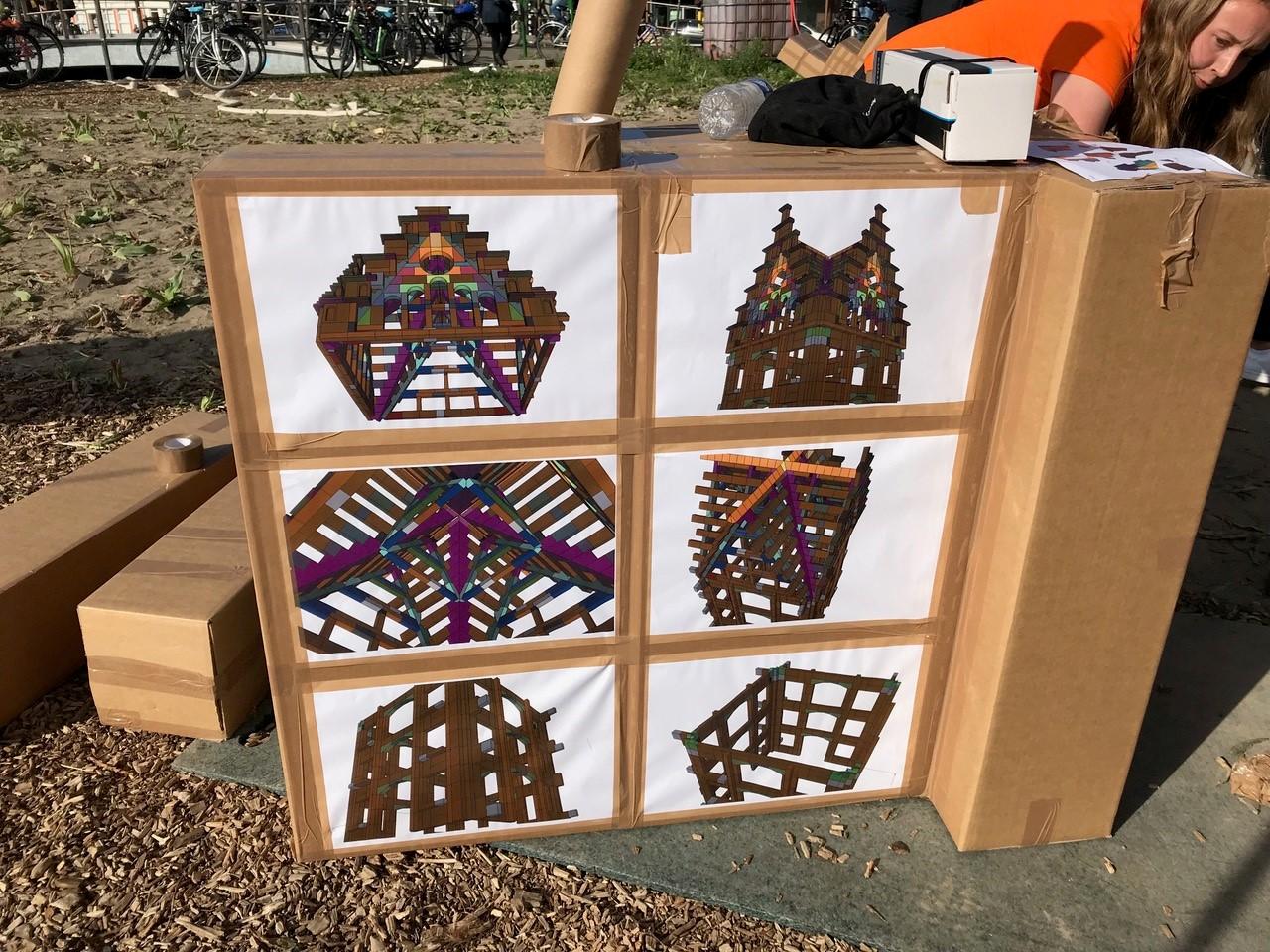 <p>Stylos en Olivier Grôssetete bouwen kartonnen kunstwerk in Nieuw Delft. Beeld Karin Janssen</p>