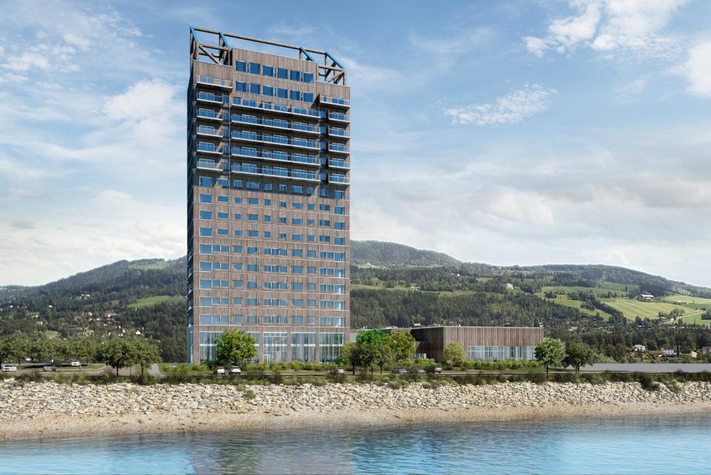 In Brumunddal (Noorwegen) staat de Mjøstårnet uit 2019, een 85 meter hoge houten woontoren van 18 verdiepingen met appartementen, binnenzwembad, hotel, kantoren, restaurants en commerciële ruimtes. Het ontwerp is van Voll Arkitekter. Beeld Voll Arkitekter Trondheim
