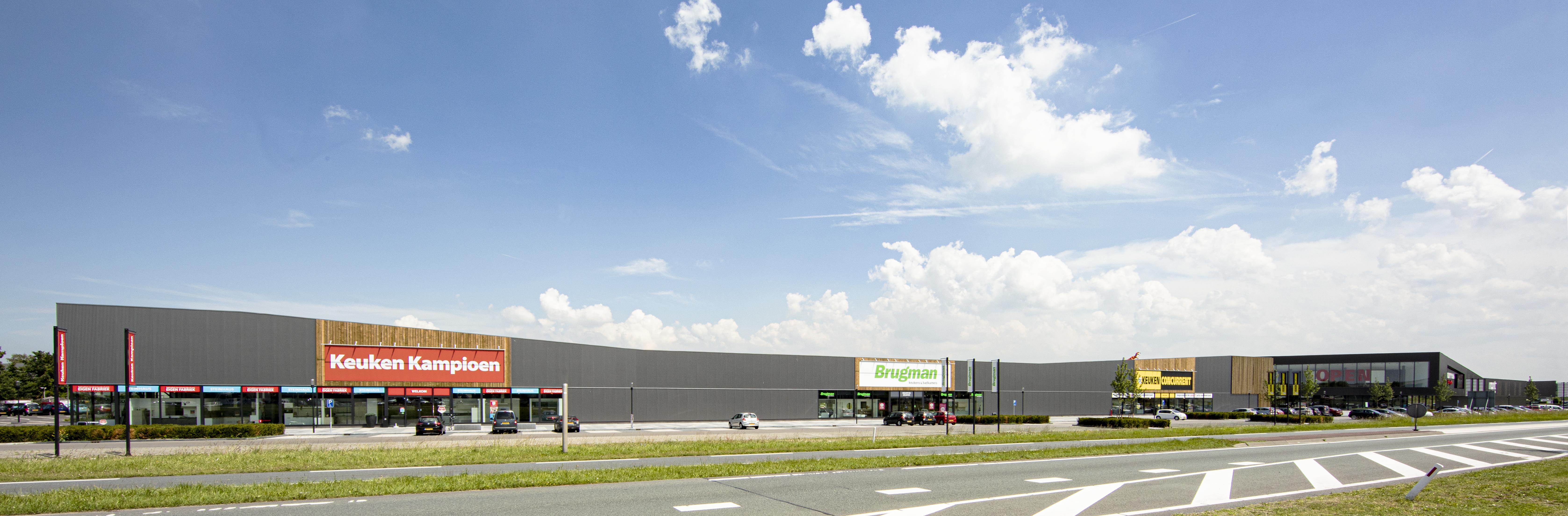 <p>Morres Meubelen Hulst &#8211; zijgevel Depot Zeven (foto: LA | Architecten Ingenieurs)</p>